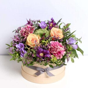 jewel tone hatbox of flowers delivered