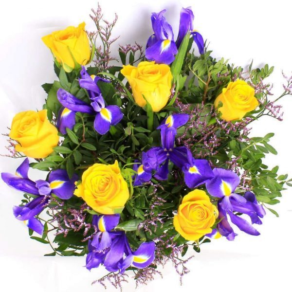 yellow roses and purple iris flowers in a bouquet