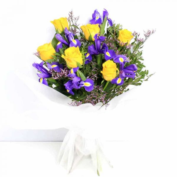 yellow roses and purple iris flowers in a water wrap